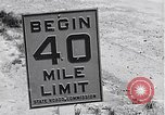 Image of signs on American highways United States USA, 1932, second 8 stock footage video 65675036982