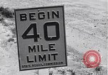 Image of signs on American highways United States USA, 1932, second 10 stock footage video 65675036982