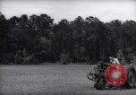 Image of farmer plows farm on tractor Savannah Georgia USA, 1939, second 10 stock footage video 65675037006