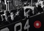 Image of U.S. troops boarding landing craft for Normandy invasion England, 1944, second 4 stock footage video 65675037050