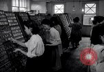 Image of young Japanese American girls work on print shop Honolulu Hawaii USA, 1942, second 2 stock footage video 65675037122