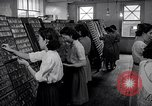 Image of young Japanese American girls work on print shop Honolulu Hawaii USA, 1942, second 3 stock footage video 65675037122