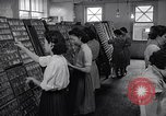 Image of young Japanese American girls work on print shop Honolulu Hawaii USA, 1942, second 4 stock footage video 65675037122