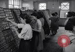 Image of young Japanese American girls work on print shop Honolulu Hawaii USA, 1942, second 5 stock footage video 65675037122