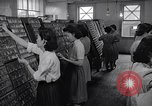 Image of young Japanese American girls work on print shop Honolulu Hawaii USA, 1942, second 6 stock footage video 65675037122