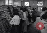 Image of young Japanese American girls work on print shop Honolulu Hawaii USA, 1942, second 7 stock footage video 65675037122