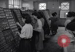 Image of young Japanese American girls work on print shop Honolulu Hawaii USA, 1942, second 8 stock footage video 65675037122