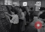 Image of young Japanese American girls work on print shop Honolulu Hawaii USA, 1942, second 9 stock footage video 65675037122