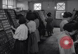 Image of young Japanese American girls work on print shop Honolulu Hawaii USA, 1942, second 10 stock footage video 65675037122