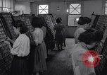 Image of young Japanese American girls work on print shop Honolulu Hawaii USA, 1942, second 11 stock footage video 65675037122