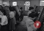Image of young Japanese American girls work on print shop Honolulu Hawaii USA, 1942, second 12 stock footage video 65675037122