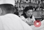 Image of Scenes in city a year after Japanese attack on Pearl Harbor Honolulu Hawaii USA, 1942, second 2 stock footage video 65675037124
