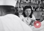 Image of Scenes in city a year after Japanese attack on Pearl Harbor Honolulu Hawaii USA, 1942, second 4 stock footage video 65675037124