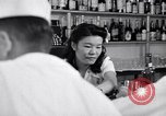 Image of Scenes in city a year after Japanese attack on Pearl Harbor Honolulu Hawaii USA, 1942, second 8 stock footage video 65675037124