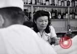 Image of Scenes in city a year after Japanese attack on Pearl Harbor Honolulu Hawaii USA, 1942, second 9 stock footage video 65675037124
