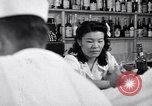 Image of Scenes in city a year after Japanese attack on Pearl Harbor Honolulu Hawaii USA, 1942, second 10 stock footage video 65675037124