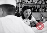 Image of Scenes in city a year after Japanese attack on Pearl Harbor Honolulu Hawaii USA, 1942, second 11 stock footage video 65675037124