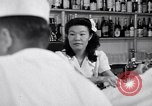 Image of Scenes in city a year after Japanese attack on Pearl Harbor Honolulu Hawaii USA, 1942, second 12 stock footage video 65675037124