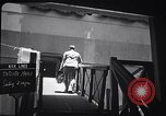 Image of A passenger boarding the Japanese ocean liner Tatsuta Maru Honolulu Hawaii USA, 1939, second 12 stock footage video 65675037128