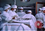 Image of Japanese-American doctors and nurses at a relocation center United States USA, 1940, second 10 stock footage video 65675037172