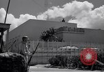 Image of army sentry at building Honolulu Hawaii USA, 1941, second 3 stock footage video 65675037192