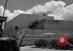 Image of army sentry at building Honolulu Hawaii USA, 1941, second 4 stock footage video 65675037192