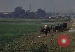 Image of heavy traffic in markets Vietnam, 1967, second 5 stock footage video 65675037262