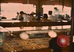 Image of various shops at market Vietnam, 1967, second 11 stock footage video 65675037263