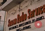 Image of signboards of various shops and services Saigon Vietnam, 1967, second 10 stock footage video 65675037265
