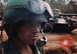Image of soldiers in tanker's helmet Lai Khe South Vietnam, 1968, second 12 stock footage video 65675037289