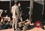 Image of unloading combat gear Vietnam, 1969, second 4 stock footage video 65675037300