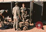 Image of unloading combat gear Vietnam, 1969, second 5 stock footage video 65675037300