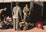 Image of unloading combat gear Vietnam, 1969, second 7 stock footage video 65675037300