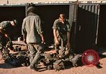 Image of unloading combat gear Vietnam, 1969, second 8 stock footage video 65675037300