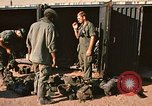 Image of unloading combat gear Vietnam, 1969, second 9 stock footage video 65675037300