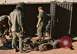 Image of unloading combat gear Vietnam, 1969, second 10 stock footage video 65675037300