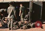 Image of unloading combat gear Vietnam, 1969, second 11 stock footage video 65675037300