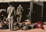 Image of unloading combat gear Vietnam, 1969, second 12 stock footage video 65675037300