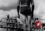 Image of prisoners swimming and playing Pacific theater, 1941, second 1 stock footage video 65675037310