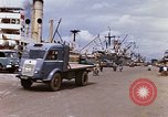 Image of Unloading of oil barrels Saigon Vietnam, 1966, second 7 stock footage video 65675037335