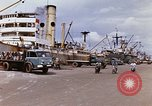 Image of Unloading of oil barrels Saigon Vietnam, 1966, second 11 stock footage video 65675037335