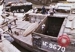 Image of scrap and cargo Saigon Vietnam, 1966, second 1 stock footage video 65675037336