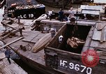 Image of scrap and cargo Saigon Vietnam, 1966, second 4 stock footage video 65675037336
