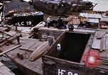 Image of scrap and cargo Saigon Vietnam, 1966, second 7 stock footage video 65675037336