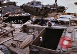 Image of scrap and cargo Saigon Vietnam, 1966, second 8 stock footage video 65675037336