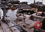 Image of scrap and cargo Saigon Vietnam, 1966, second 12 stock footage video 65675037336
