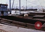 Image of Cargo being loaded in trucks Saigon Vietnam, 1966, second 4 stock footage video 65675037337