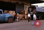 Image of loading cargo onto military trucks Saigon Vietnam, 1966, second 9 stock footage video 65675037338