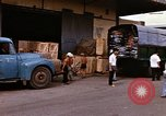 Image of loading cargo onto military trucks Saigon Vietnam, 1966, second 10 stock footage video 65675037338