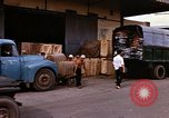 Image of loading cargo onto military trucks Saigon Vietnam, 1966, second 11 stock footage video 65675037338